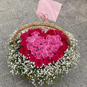 red pink roses basket